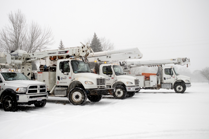 Trucks from the Bowlin Group, an energy company from Kentucky, idle in the parking lot of Plymouth Heights Christian Reformed Church in Grand Rapids, Mich., on Friday, Feb. 8, 2019. The church served as a staging area for the vehicles. (Neil Blake/The Grand Rapids Press via AP)