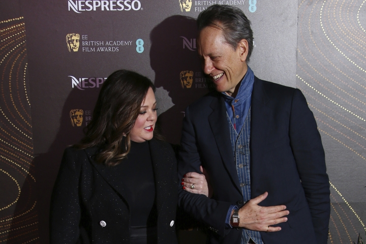 Actors Melissa McCarthy, left, and Richard E. Grant pose for photographers upon arrival at the BAFTA Nominees Party in London, Saturday, Feb. 9, 2019. (Photo by Joel C Ryan/Invision/AP)