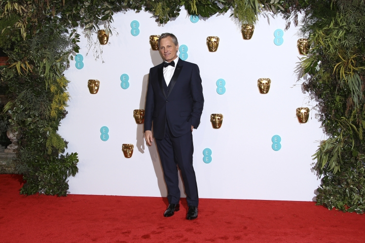 Actor Viggo Mortensen poses for photographers upon arrival at the BAFTA awards in London, Sunday, Feb. 10, 2019. (Photo by Joel C Ryan/Invision/AP)