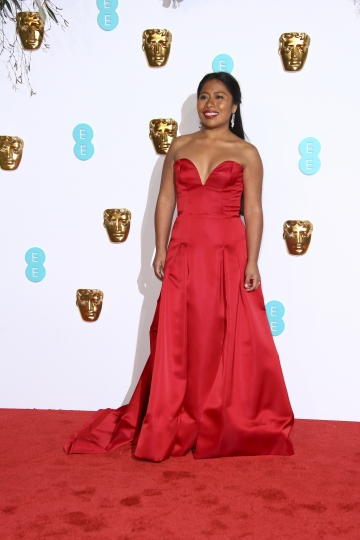 Actress Yalitza Aparicio poses for photographers upon arrival at the BAFTA awards in London, Sunday, Feb. 10, 2019. (Photo by Joel C Ryan/Invision/AP)