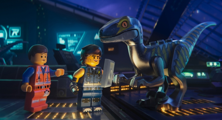 """This image released by Warner Bros. Pictures shows the characters Emmet, left, and Rex Dangervest, center, both voiced by Chris Pratt, in a scene from """"The Lego Movie 2: The Second Part."""" (Warner Bros. Pictures via AP)"""
