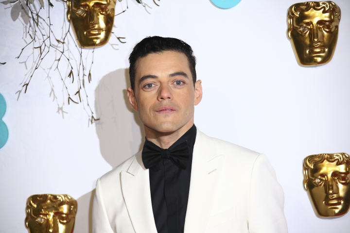 Actor Rami Malek poses for photographers upon arrival at the BAFTA awards in London, Sunday, Feb. 10, 2019. (Photo by Joel C Ryan/Invision/AP)