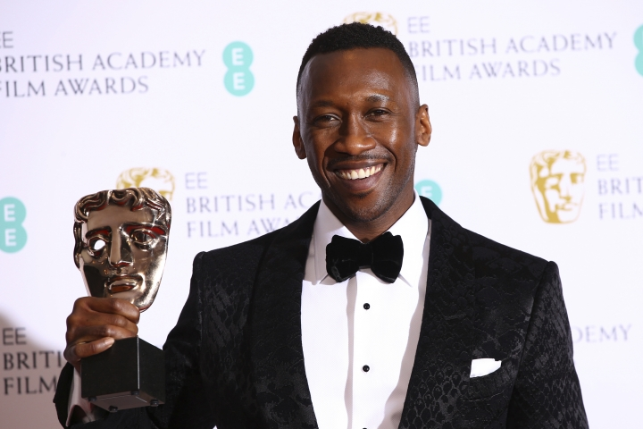 Actor Mahershala Ali poses for photographers backstage with the Best Supporting Actor award for his role in the film 'Green Book' at the BAFTA awards in London, Sunday, Feb. 10, 2019. (Photo by Joel C Ryan/Invision/AP)