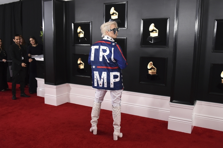 Ricky Rebel arrives at the 61st annual Grammy Awards at the Staples Center wearing a jacket with the word Trump on it, on Sunday, Feb. 10, 2019, in Los Angeles. (Photo by Jordan Strauss/Invision/AP)