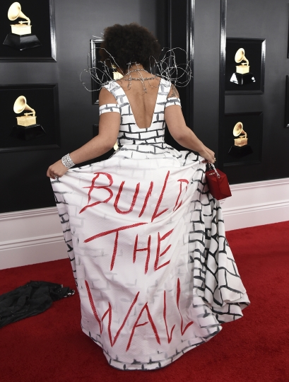"""Joy Villa arrives at the 61st annual Grammy Awards at the Staples Center wearing a dress that reads """"Build the Wall"""" on Sunday, Feb. 10, 2019, in Los Angeles. (Photo by Jordan Strauss/Invision/AP)"""
