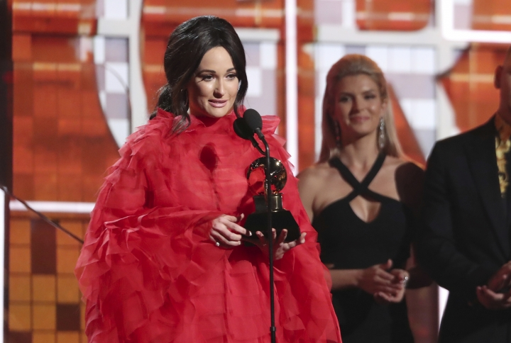 """Kacey Musgraves accepts the award for best country album for """"Golden Hour"""" at the 61st annual Grammy Awards on Sunday, Feb. 10, 2019, in Los Angeles. (Photo by Matt Sayles/Invision/AP)"""