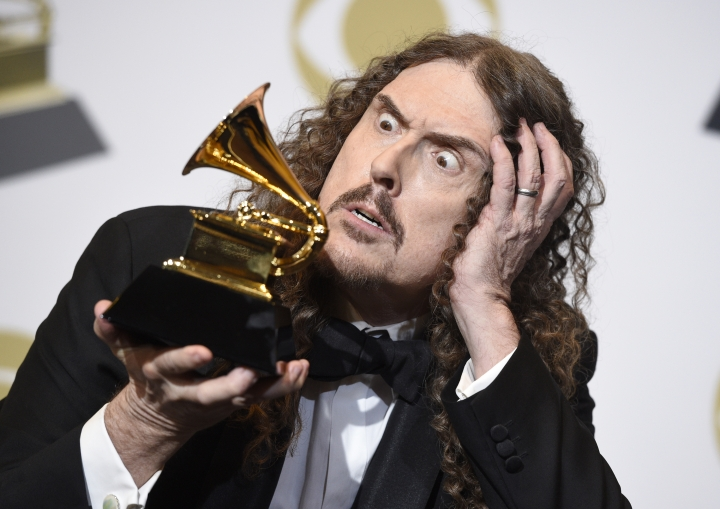 """""""Weird Al"""" Yankovic poses in the press room with the award for best boxed or special limited edition package for """"Squeeze Box: The Complete Works of 'Weird Al' Yankovic"""" at the 61st annual Grammy Awards at the Staples Center on Sunday, Feb. 10, 2019, in Los Angeles. (Photo by Chris Pizzello/Invision/AP)"""