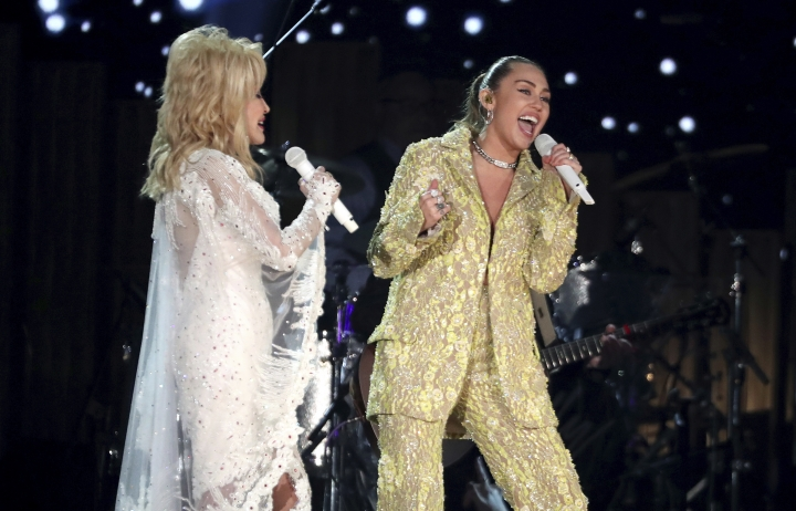 """Dolly Parton, left, and Miley Cyrus perform """"Jolene"""" at the 61st annual Grammy Awards on Sunday, Feb. 10, 2019, in Los Angeles. (Photo by Matt Sayles/Invision/AP)"""