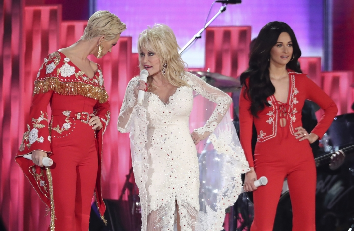 "Katy Perry, from left, Dolly Parton and Kacey Musgraves perform ""Here You Come Again"" at the 61st annual Grammy Awards on Sunday, Feb. 10, 2019, in Los Angeles. (Photo by Matt Sayles/Invision/AP)"