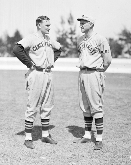 FILE - In this Feb. 25, 1935 file photo, John Mize, left, chats with coach George Kelly as he reports for spring training at the Cincinnati Reds' camp in Tampa, Fla. (AP Photo, File)