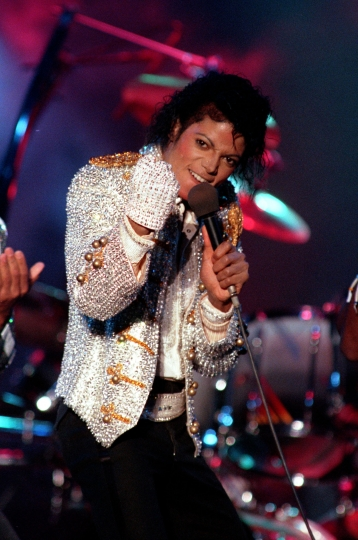 "FILE - In this Dec. 3, 1984 photo, Michael Jackson performs with his brothers at Dodger Stadium in Los Angeles, as part of their Victory Tour concert. The Michael Jackson estate has sent a letter to the U.K.'s Channel 4 warning that a documentary on men who accuse the singer of molesting them as boys violates the network's programming guidelines. Estate attorneys say in the letter released to The Associated Press on Monday, Feb. 11, 2019, that ""Leaving Neverland,"" includes no response from Jackson defenders as the channel's guidelines require. (AP Photo/Doug Pizac, File)"