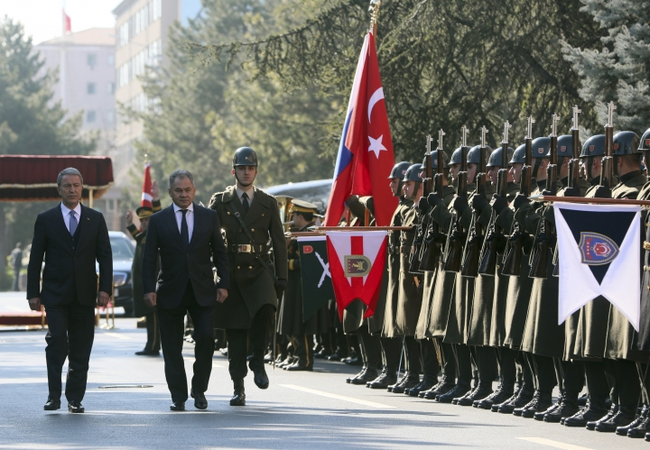 """Turkish Defence Minister Hulusi Akar, left, and Russia's Defence Minister Sergei Shoigu inspect a military honour guard before their talks in Ankara, Turkey, Monday, Feb. 11, 2019. Shoigu said at the start of Monday's meeting with his Turkish counterpart Akar that the two countries' experts have done """"a lot of work to coordinate on issues related to the stabilization in Idlib and issues related to the east bank of the Euphrates River."""" (Defence Ministry via AP, Pool)"""