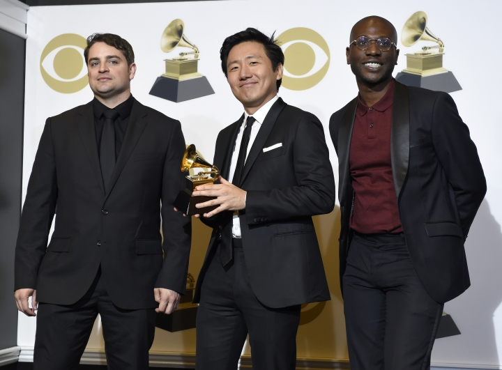 "Jason Cole, from left, Hiro Murai and Ibra Ake pose in the press room with the award for best music video for Childish Gambino's ""This Is America"" at the 61st annual Grammy Awards at the Staples Center on Sunday, Feb. 10, 2019, in Los Angeles. (Photo by Chris Pizzello/Invision/AP)"