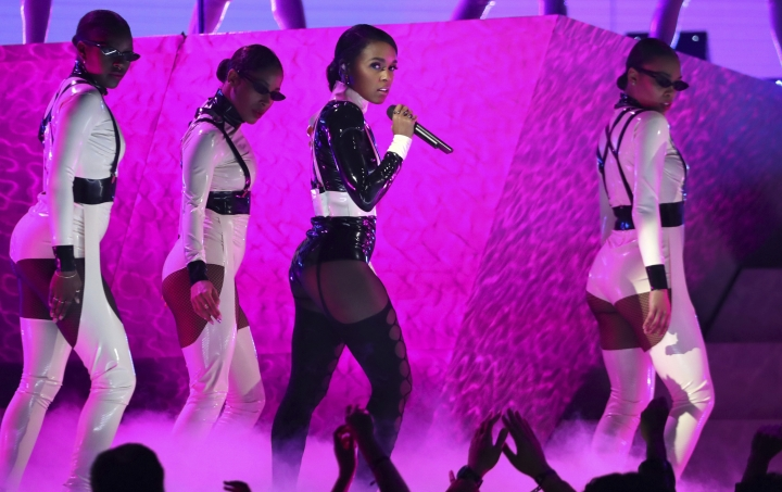 """Janelle Monae, center, performs """"Make Me Feel"""" at the 61st annual Grammy Awards on Sunday, Feb. 10, 2019, in Los Angeles. (Photo by Matt Sayles/Invision/AP)"""