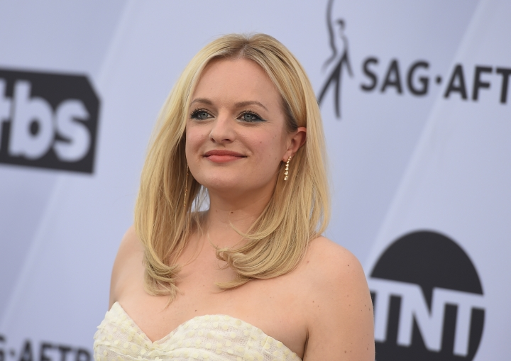 "FILE - In a Jan. 27, 2019 file photo, Elisabeth Moss arrives at the 25th annual Screen Actors Guild Awards at the Shrine Auditorium & Expo Hall, in Los Angeles. Hulu said Monday, Feb. 11, 2019 that the dystopian drama ""The Handmaid's Tale"" will debut three new episodes on Wednesday, June 5. (Photo by Jordan Strauss/Invision/AP, File)"