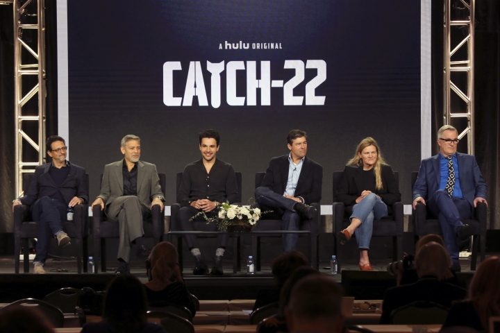 "Grant Heslov, from left, George Clooney, Christopher Abbott, Kyle Chandler, Ellen Kuras and Luke Davies participate in the ""Catch-22"" panel during the Hulu presentation at the Television Critics Association Winter Press Tour at The Langham Huntington on Monday, Feb. 11, 2019, in Pasadena, Calif. (Photo by Willy Sanjuan/Invision/AP)"