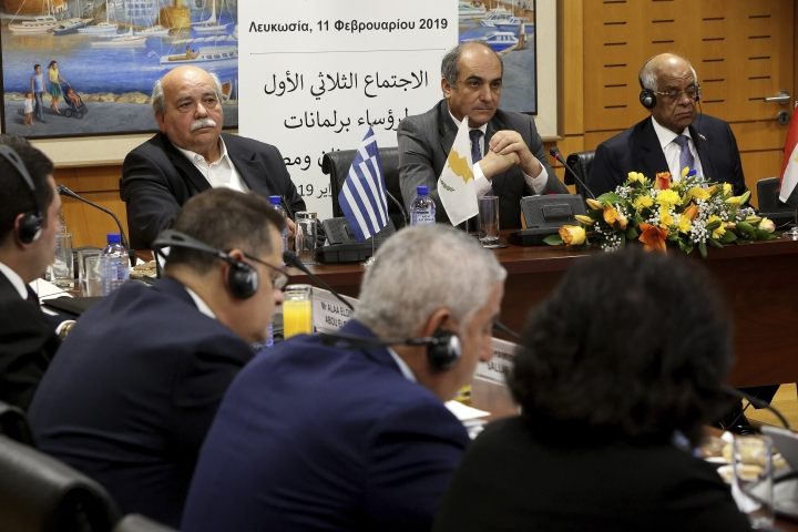 Cypriot Parliamentary Speaker Demetris Syllouris, center, with his counterparts Ali Abdel-Aal of Egypt, right, and Nikos Voutsis of Greece, left, talk during a press conference in the parliament house in capital Nicosia, Cyprus, Monday, Feb. 11, 2019. Syllouris, Abdel-Aal and Voutsis agreed on strengthening cooperation especially in the fields of energy, tourism, education and culture. (AP Photo/Petros Karadjias)