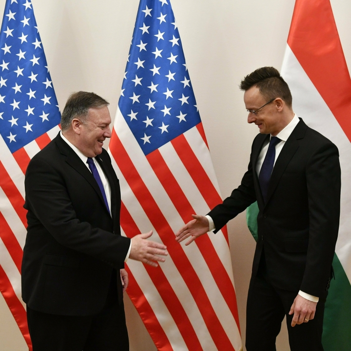 Hungarian Minister of Foreign Affairs and Trade Peter Szijjarto, right, greets US Secretary of State Mike Pompeo in the ministry in Budapest, Hungary, Monday, February 11, 2019. Pompeo is on an official visit to Hungary. (Zsolt Szigetvary/MTI via AP)