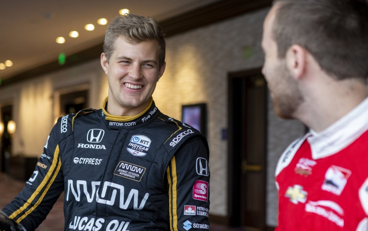 IndyCar driver Marcus Ericsson, of Sweden, speaks with fellow driver Ed Jones during IndyCar auto racing media day, Monday, Feb. 11, 2019, in Austin, Texas. (AP Photo/Stephen Spillman)