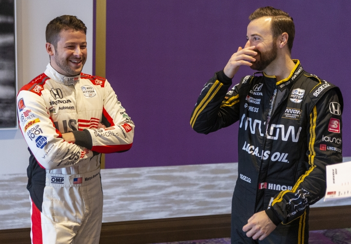 IndyCar drivers Marco Andretti, left, and James Hinchcliffe speak during IndyCar auto racing media day, Monday, Feb. 11, 2019, in Austin, Texas. (AP Photo/Stephen Spillman)