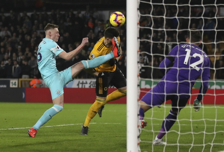 Wolverhampton Wanderers' Matt Doherty heads the ball, during the English Premier League soccer match between Wolverhampton Wanderers and Newcastle United, at Molineux, in Wolverhampton, England, Monday, Feb. 11, 2019. (Nick Potts/PA via AP)