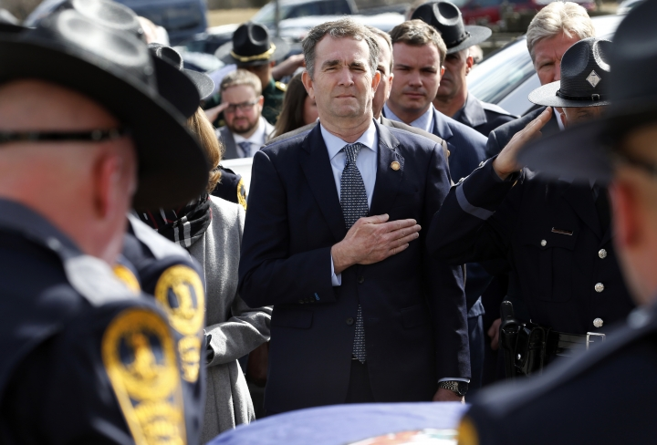 Virginia Gov. Ralph Northam, left, and his wife Pam, watch as the casket of fallen Virginia State Trooper Lucas B. Dowell is carried to a waiting tactical vehicle during the funeral at the Chilhowie Christian Church in Chilhowie, Va., Saturday, Feb. 9, 2019. Dowell was killed in the line of duty earlier in the week. (AP Photo/Steve Helber, Pool)