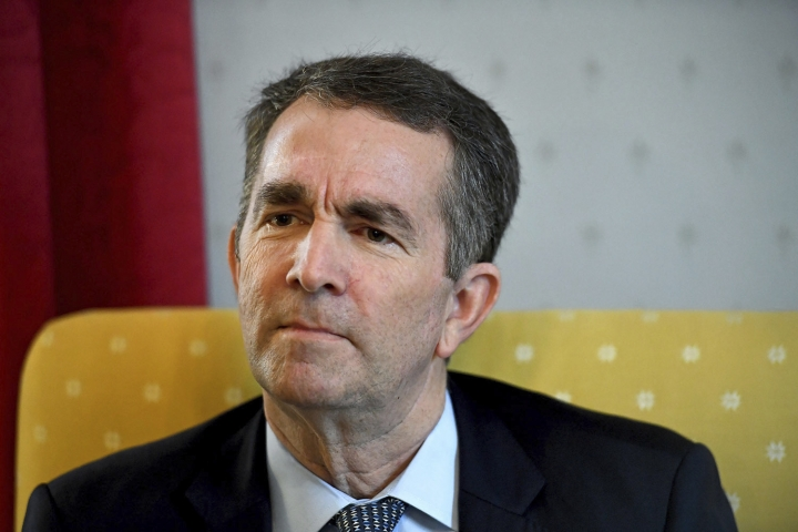 """Virginia Gov. Ralph Northam talks during an interview at the Governor's Mansion, Saturday, Feb. 9, 2019 in Richmond, Va. The embattled governor says he wants to spend the remaining three years of his term pursuing racial """"equity."""" Northam told The Washington Post that there is a higher reason for the """"horrific"""" reckoning over a racist photograph that appeared in his medical school yearbook. (Katherine Frey/The Washington Post via AP)"""