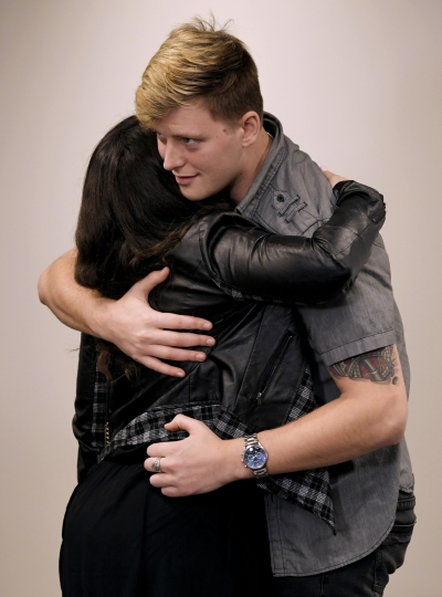 Carverton publicist Jen Apple hugs band member Michael Wiebel after a news conference about the killing of fellow member Kyle Yorlets at Belmont University in Nashville, Tenn., Monday, Feb. 11, 2019. Yorlets, the frontman for the rock band Carverton was gunned down during a robbery Thursday, Feb. 7. Police have charged five juveniles in the case. A memorial service was scheduled to follow. (Shelley Mays/The Tennessean via AP)