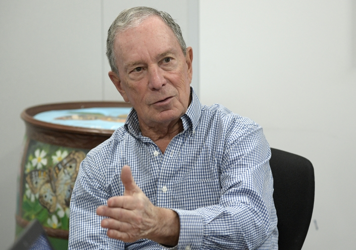 "FILE - In this Feb. 8, 2019, photo, former New York City Mayor Michael Bloomberg answers an question during an interview with The Associated Press in Orlando, Fla. Bloomberg measures his progress on climate change in metric tons. His political party, it seems, prefers big ideas. Many Democratic presidential contenders embraced the ""Green New Deal"" immediately after it was released last week. (AP Photo/Phelan M. Ebenhack)"