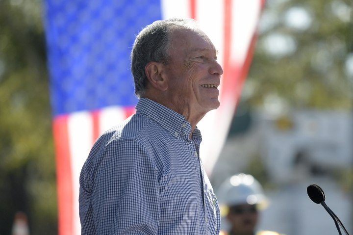 """In this Feb. 8, 2019, photo, former New York City Mayor Michael Bloomberg speaks during a visit to an Orlando Utilities Commission facility in Orlando, Fla. Bloomberg measures his progress on climate change in metric tons. His political party, it seems, prefers big ideas. Many Democratic presidential contenders embraced the """"Green New Deal"""" immediately after it was released last week.(AP Photo/Phelan M. Ebenhack)"""