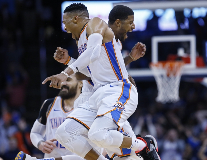 Oklahoma City Thunder guard Russell Westbrook, left, and forward Paul George, right, celebrate late in the second half of an NBA basketball game against the Portland Trail Blazers in Oklahoma City, Monday, Feb. 11, 2019. (AP Photo/Sue Ogrocki)