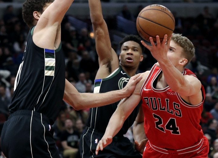 Chicago Bulls forward Lauri Markkanen, right, shoots against Milwaukee Bucks center Brook Lopez, left, and forward Giannis Antetokounmpo during the first half of an NBA basketball game Monday, Feb. 11, 2019, in Chicago. (AP Photo/Nam Y. Huh)