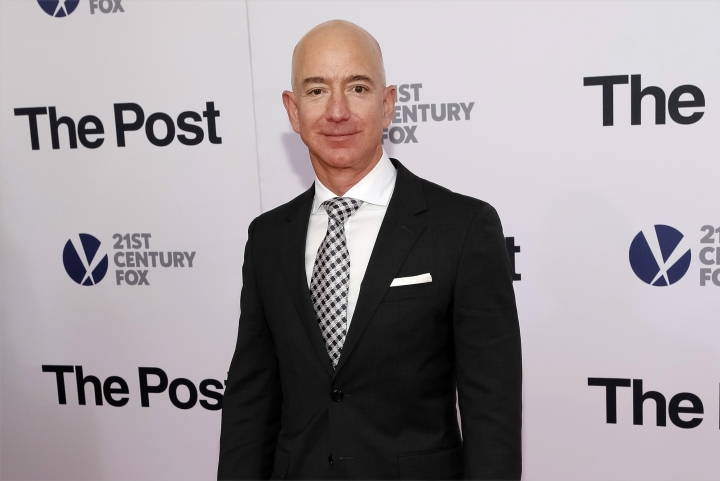 "FILE - In this Dec. 14, 2017, file photo, Jeff Bezos attends the premiere of ""The Post"" at The Newseum in Washington. Private investigators working for Bezos have determined the brother of the Amazon CEO's mistress leaked the couple's intimate text messages to the National Enquirer. That's according to a person familiar with the matter who spoke Monday to The Associated Press. (Photo by Brent N. Clarke/Invision/AP)"