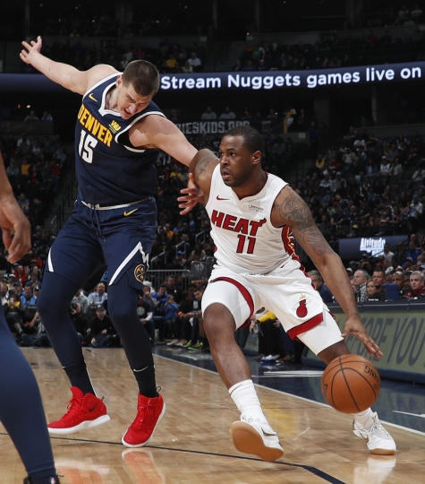 Miami Heat guard Dion Waiters, right, drives past Denver Nuggets center Nikola Jokic in the first half of an NBA basketball game Monday, Feb. 11, 2019, in Denver. (AP Photo/David Zalubowski)
