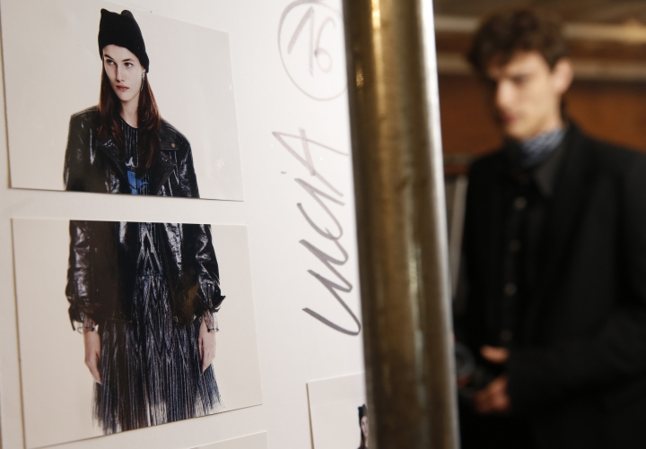 A model waits backstage before the Zadig & Voltaire fashion show is modeled during Fashion Week Monday, Feb. 11, 2019, in New York. (AP Photo/Kathy Willens)