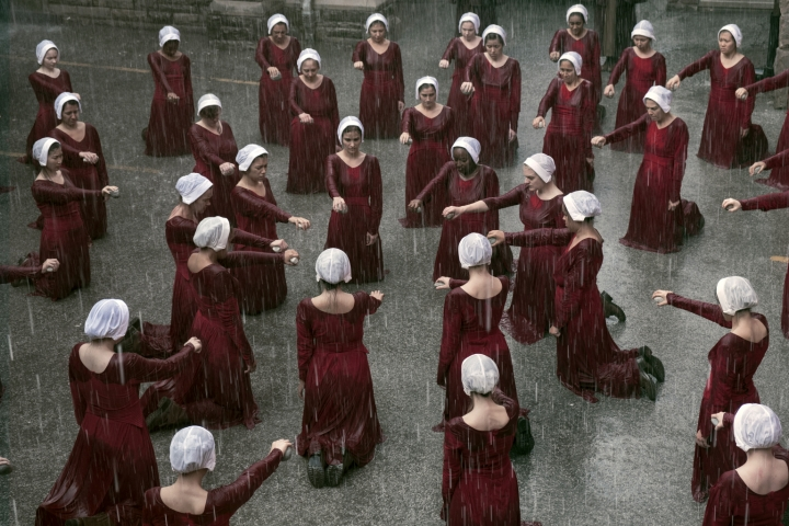 """This image released by Hulu shows a scene from the series, """"The Handmaid's Tale,"""" returning for a third season on June 5. (George Kraychyk/Hulu via AP)"""