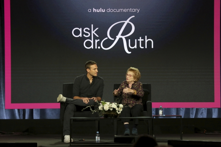 """Ryan White, left, and Dr. Ruth Westheimer participate in the """"Ask Dr. Ruth"""" panel during the Hulu presentation at the Television Critics Association Winter Press Tour at The Langham Huntington on Monday, Feb. 11, 2019, in Pasadena, Calif. (Photo by Willy Sanjuan/Invision/AP)"""