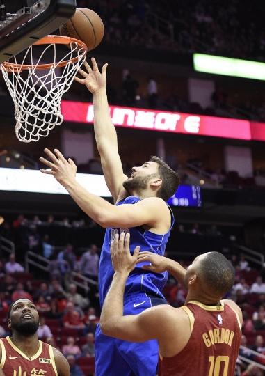 Dallas Mavericks forward Maximilian Kleber, left, shoots over Houston Rockets guard Eric Gordon during the first half of an NBA basketball game, Monday, Feb. 11, 2019, in Houston. (AP Photo/Eric Christian Smith)