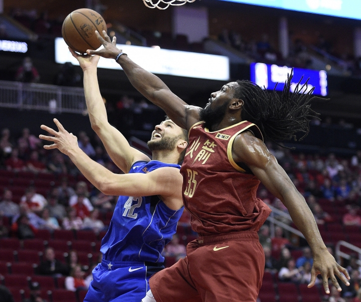 Dallas Mavericks forward Maximilian Kleber, left, shorts as Houston Rockets forward Kenneth Faried defends during the first half of an NBA basketball game, Monday, Feb. 11, 2019, in Houston. (AP Photo/Eric Christian Smith)