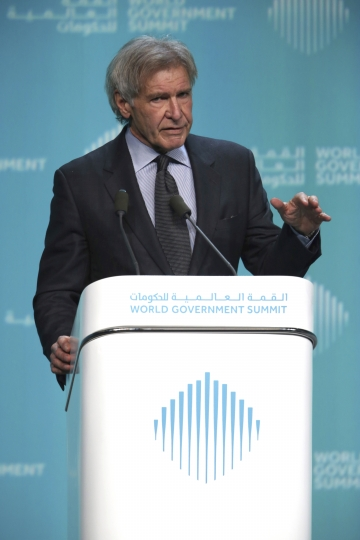 """American actor Harrison Ford speaks about ocean conservation at the World Government Summit in Dubai, United Arab Emirates, Tuesday, Feb. 12, 2019. Ford offered an emphatic plea for protecting the world's oceans while calling out U.S. President Donald Trump and others who """"deny or denigrate science."""" (AP Photo/Jon Gambrell)"""