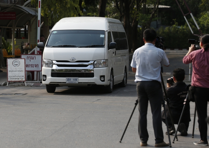 A van believed to be carrying refugee soccer player Bahraini Hakeem al-Araibi leaves a prison, Monday, Feb. 11, 2019, in Bangkok, Thailand. A Thai court has ordered the release of al-Araibi after prosecutors said they were no longer seeking his extradition to Bahrain. (AP Photo/Sakchai Lalit)