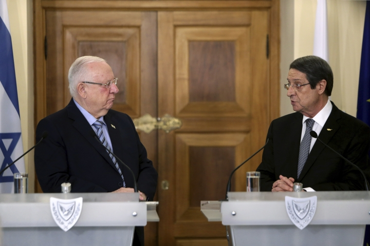 Cyprus' president Nicos Anastasiades, right, and Israel's President Reuven Rivlin talk, during a press conference after their meeting at the presidential palace in divided capital Nicosia, Cyprus, Tuesday, Feb. 12, 2019. Rivlin is in Cyprus for a one-day official visit for talks. (AP Photo/Petros Karadjias)