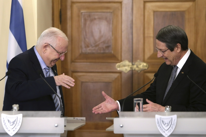 Cyprus' president Nicos Anastasiades, right, shakes hands with Israel's President Reuven Rivlin after their meeting at the presidential palace in divided capital Nicosia, Cyprus, on Tuesday, Feb. 12, 2019. Rivlin is in Cyprus for a one-day official visit for talks. (AP Photo/Petros Karadjias)