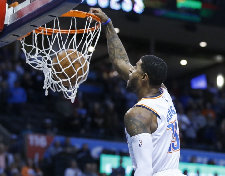 Oklahoma City Thunder forward Paul George (13) dunks in the first half of an NBA basketball game against the Portland Trail Blazers in Oklahoma City, Monday, Feb. 11, 2019. (AP Photo/Sue Ogrocki)