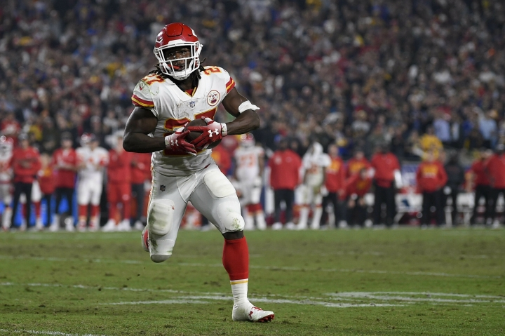 File- This Nov. 19, 2018, file photo shows Kansas City Chiefs running back Kareem Hunt in action during the second half of an NFL football game against the Los Angeles Rams in Los Angeles. The lasting image of Kareem Hunt's second NFL season wasn't him stiff-arming a linebacker, shedding a tackle or barreling over a cornerback at the goal line for a touchdown. It was him pushing a woman and then kicking her while she was defenseless on the floor. That disturbing moment caught on surveillance video mortified the sports world. The Cleveland Browns believe it was a random act by a young man who feels remorse and deserves a second chance. (AP Photo/Kelvin Kuo, File)