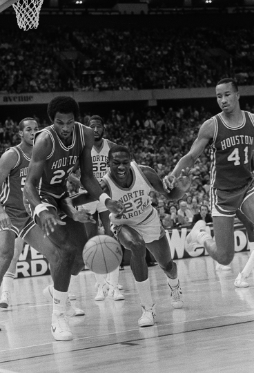 File- This March 29, 1982, file photo shows Houston's Clyde Drexler, left, and North Carolina's Michael Jordan, center, battling for the ball during NCAA semifinal final game in New Orleans. It's well-known that Jordan uses failure to motivate him. The only thing seemingly that has eluded the 55-year-old Jordan is ultimate success as an executive and team owner. His Hornets have yet to win a playoff series since he took over as majority owner nine years ago and they remain marred in NBA mediocrity while struggling to compete in a small market. But Jordan wants to keep his team, and the city, relevant. It's one reason he aggressively pursued the All-Star game with such vigor. (AP Photo/ File)
