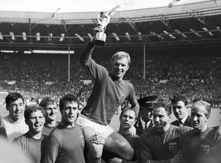 FILE - In this July 30, 1966 file photo England's soccer team captain Bobby Moore, is carried shoulder high by his team mates holding World Cup on July 30, 1966. England defeated West Germany 4-2 in the final, played at London's Wembley Stadium. From left to right, goalkeeper Gordon Banks, Alan Ball, Roger Hunt, Geoff Hurst, Moore, Ray Wilson, George Cohen and Bobby Charlton. English soccer club Stoke said Tuesday Feb. 12, 2019 that World Cup-winning England goalkeeper Gordon Banks has died at 81. (AP Photo/Bippa, File)
