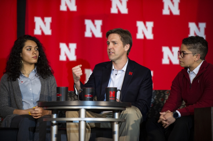 "In this Monday, Feb. 11, 2019 photo, U.S. Ben Sasse, R-Neb., answers a question posed to him during a panel discussion for the University of Nebraska's Charter Week Celebration while students Grace Chambers, left, and Kamryn Sannicks listen in Lincoln, Neb. Sasse said technology has undermined traditional community structures, and ideology or ""political tribes"" are rushing to fill the void. He said political parties aren't adequate replacements for communities. (Savannah Blake/Lincoln Journal Star via AP)"