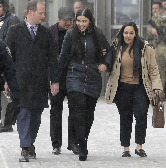"Emma Coronel Aispuro, center, wife of Joaquin ""El Chapo"" Guzman, leaves federal court in New York, Tuesday, Feb. 12, 2019. On Tuesday, Mexico's most notorious drug lord was convicted of running an industrial-scale smuggling operation after a three-month trial packed with Hollywood-style tales of grisly killings, political payoffs, cocaine hidden in jalapeno cans, jewel-encrusted guns and a naked escape with his mistress through a tunnel. (AP Photo/Seth Wenig)"