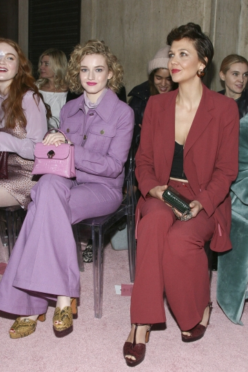 Julia Garner, left, and Maggie Gyllenhaal, right, attend the NYFW Fall/Winter 2019 Kate Spade fashion show at the Cipriani's on Friday, Feb. 8, 2019, in New York. (Photo by Andy Kropa/Invision/AP)